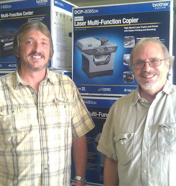 Men In Front Of Boxed Copiers